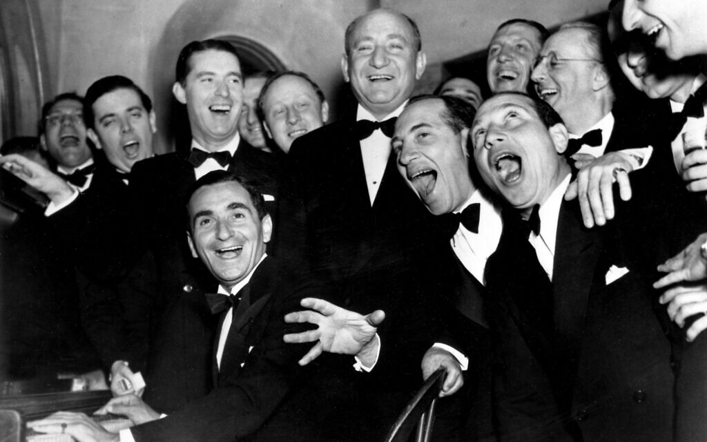 Irving Berlin, at the piano, and friends celebrate the 25th year since he wrote 'Alexander's Rag Time Band' at a banquet in his honor in Hollywood, California, January 20, 1936.  Standing behind Berlin, at right, is Joseph Schenck, film producer.  In front row singing together are two of the Marx Brothers, Chico and Harpo.  (AP Photo)