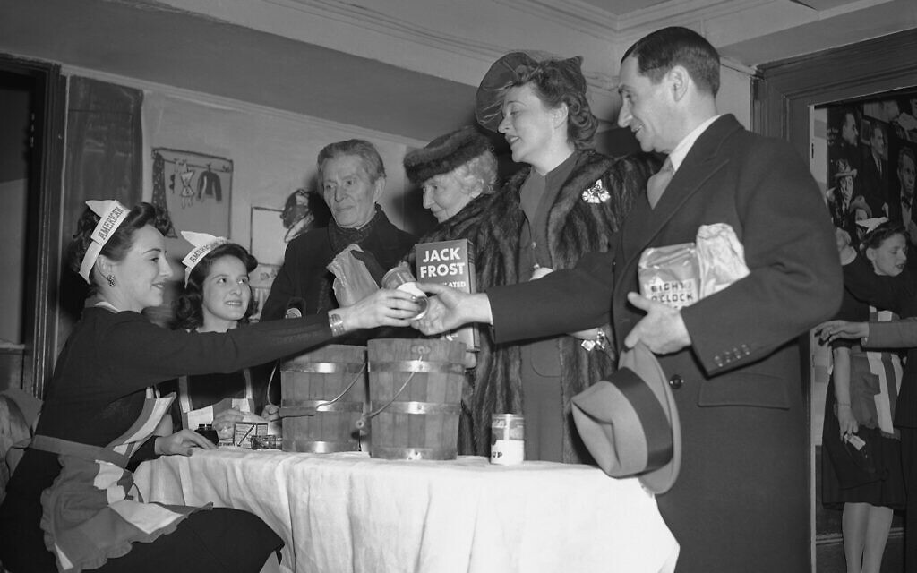 Left to right: Mary Stevenson and Allyn Van Baalen, hostesses; Morris Gest, producer; Rachel Crothers, playwright; Jessie Royce Landis, actress, and Irving Berlin, song writer, at the Stage Door canteen at an event for US soldiers, February 28, 1942. (AP Photo/Marty Zimmerman)