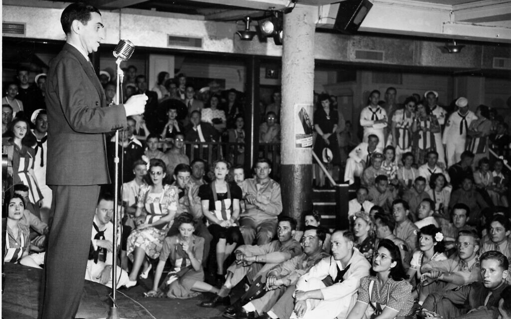 Composer Irving Berlin sings his song 'God Bless America' for service men at the Stage Door Canteen in New York City, July 9, 1942. (AP Photo)
