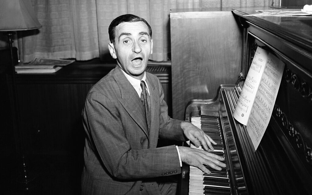 'Be Careful, It's My Heart,' is the song Irving Berlin sings during an interview in Berlin's New York office, July 16, 1942. (AP Photo/Murray Becker)
