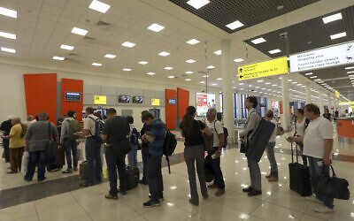 Illustrative: Passengers stand waiting at Sheremetyevo Airport in Moscow, June 27, 2013. (Sergei Grits/AP)