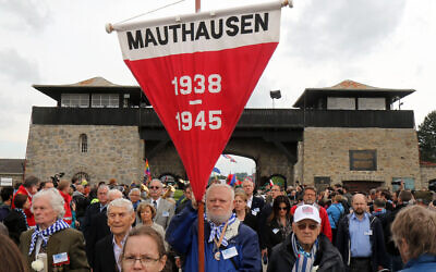 Members of the international Mauthausen committee arrive for a ceremony to commemorate the 70th anniversary of the liberation of the Nazi concentration camp in Mauthausen, Austria, Sunday, May 10, 2015. . (AP Photo/Ronald Zak)
