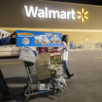 Holiday shoppers leaves Walmart's Black Friday event in Bentonville, Arkansas, on November 24, 2016. (Gunnar Rathbun/AP Images for Walmart)