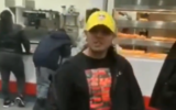 A screen capture from video of a man, identified as Justin Pichizaca, threatening a rabbi at a Costco in Lawrence, Long Island. (Screen capture: Twitter)
