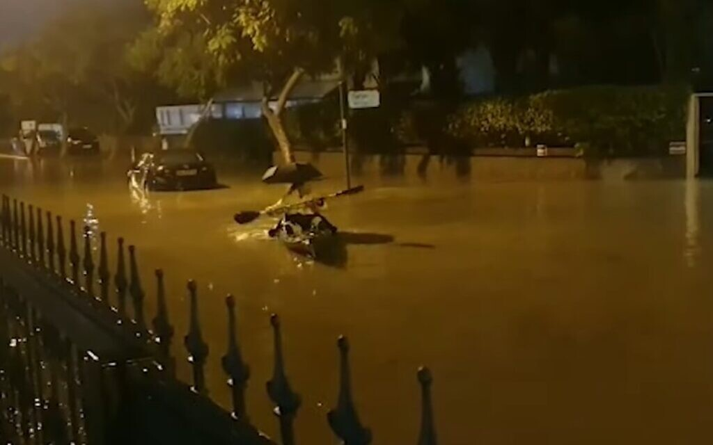Rescuers save 8 people from submerged vehicles as roads flood in southern Israel