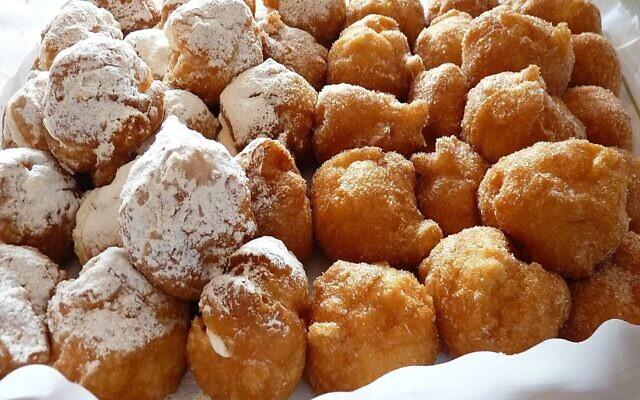 Bunuelos, a type of doughnut, is often prepared by Sephardic Jews on Hanukkah. (CC-SA/2.0/ Juan Mejuto)