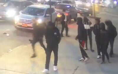 Teenagers throw a folding chair at a Hasidic teenager in a previously unreported attack on December 24, 2019. (Screengrab)
