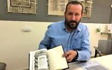 Dr. Idan Perez holds the 'Siddur Catalunya,' a reconstruction of the prayer book used in parts of pre-Expulsion Catalonia, at Jerusalem's National Library, September 15, 2019. (Amanda Borschel-Dan/Times of Israel)