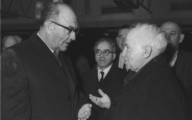 Prime Minister Levi Eshkol (L) and David Ben-Gurion at Lydda Airport before the latter's departure to England for Winston Churchill's funeral, January 1965. (GPO)