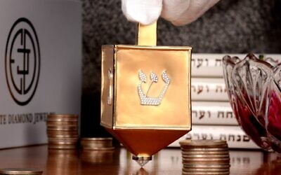 The $70,000 dreidel made of 18K yellow gold and encrusted with 220 round brilliant diamonds created by Estate Diamond Jewelry in New York City was named the world's most valuable dreidel by Guinness World Records. (Courtesy of Estate Diamond Jewelry via JTA)