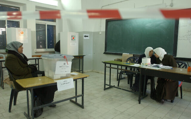 In this 9 January 2005 file photo, Palestinian women guard the ballot boxes for the Palestinian Authority Election. ( Sharon Perry/Flash90)