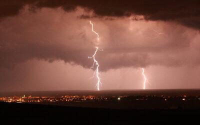 Illustrative: Lightning illuminates the sky over Nahariya during a rain storm on October 26 2012. (Yossi Zamir/Flash 90)