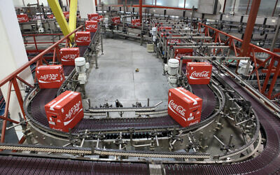 Boxed Coca-Cola bottles lined up at the Coca Cola factory in Bnei Brak, November 23, 2009. (Yaakov Naumi/Flash90)