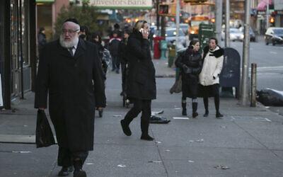 Illustrative: Ultra-Orthodox Jews seen walking on a street in New York City on January 1, 2014. (Nati Shohat/Flash 90/File)