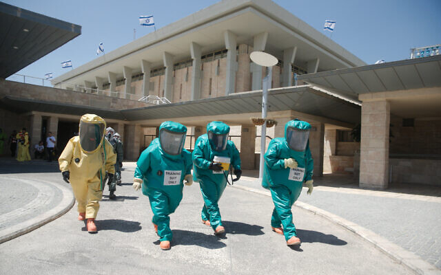 Illustrative: Members of the Knesset Honor Guard, Home Front Command, Firefighters, IDF, and Israel Police, participate in an emergency drill simulating a drone attack on the Knesset territory with a chemical substance, on June 16, 2016. (Yaniv Nadav/Flash90)
