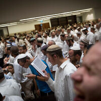 Jewish men pray at the new building of Har Hamor Yeshiva in the neighborhood of Har Homa, Jerusalem on August 22, 2017. (Yonatan Sindel/Flash90)