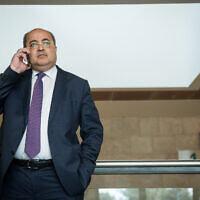 Joint list party member Ahmad Tibi arrives for a meeting at the Knesset on September 22, 2019. (Yonatan Sindel/Flash90)
