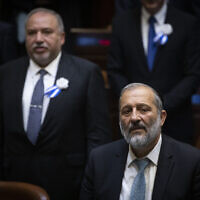 Shas chairman Interior Minister Aryeh Deri, forward right, and Yisrael Beytenu leader MK Avigdor Liberman, left rear, at the plenum hall during the opening of the 22nd Knesset, in Jerusalem, on October 3, 2019. (Hadas Parush/ Flash90)