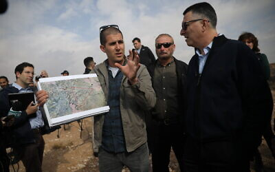 Likud Gideon Sa'ar, right, visits in the West Bank area known as E1 near Ma'ale Adumim, on December 10, 2019. (Hadas Parush/Flash90)