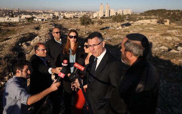 Likud MK Gideon Sa'ar speaks with media on December 19, 2019, at the Givat HaMatos hill, a neighborhood under development in an area of Jerusalem captured by Israel in the 1967 war. (Noam Rivkin Fenton/Flash90)
