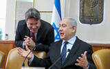 Prime Minister Benjamin Netanyahu speaks with Science Minister Ofir Akunis (L) at the start the weekly cabinet meeting on December 22, 2019, at the Prime Minister's Office in Jerusalem. (Marc Israel Sellem/Pool/Flash90)