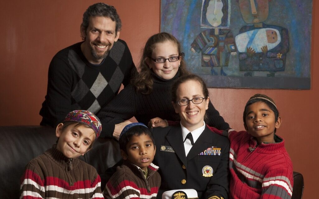Hall and her family were awarded the National Military Family Association Public Health Service Family of the Year Award in 2009. Seated left to right: Back row: David Horesh and Divya, Front row: Ilan, Rabiv, Hall, and EliNoam. (Courtesy)