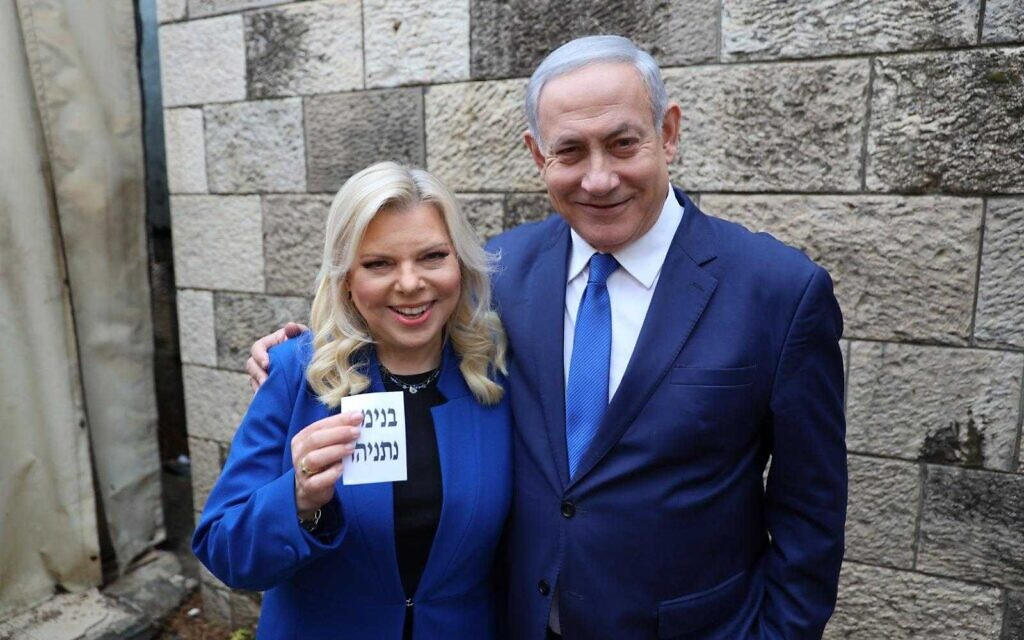 Prime Minister Benjamin Netanyahu and his wife Sara after casting votes at a polling station in Jerusalem during the Likud leadership primary on December 26, 2019. (Courtesy)