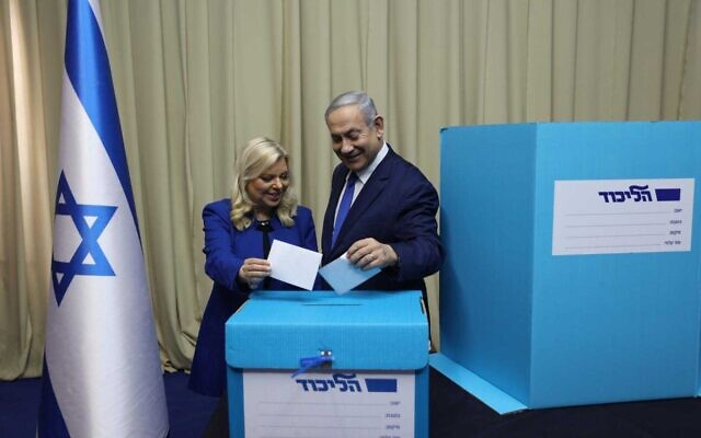 Prime Minister Benjamin Netanyahu (R) casts a vote with his wife Sara at a polling station in Jerusalem during the Likud leadership primary on December 26, 2019. (Courtesy)