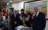 Prime Minister Benjamin Netanyahu (R) speaks at a Hanukkah candle-lighting event at the Prime Minister's Office in Jerusalem, December 29, 2019. (Kobi Gideon/GPO)