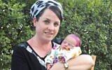 Tzippi Rimel (L) holds her daughter Noam. (Courtesy)