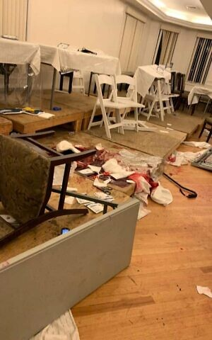 The scene inside the home of Chaim Leibish Rottenberg in Monsey after a man wielding a machete attacked people attending a Hanukkah celebration (Courtesy)
