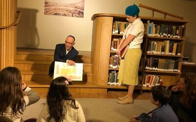 Siblings Yeshayahu and Nechama Leibowitz disagree over the existence of ghosts at the National Library's Night in the Library Hanukkah program, December 23, 2019. (Amanda Borschel-Dan/Times of Israel)