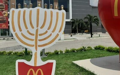 The 7-foot-tall candelabrum at a McDonald's has become a photo op in Manaus, Brazil. (Marcus Gilban/JTA)