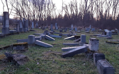 Illustraitve: Vandalized headstones at the ancient Jewish cemetery of Námestovo, Slovakia, in December 2019. (Courtesy of ZCN via JTA)