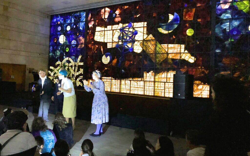 Gershom Sholem, Yeshayahu and Nechama Leibowitz, and Miriam Yalan-Stekelis help bring back the light at the National Library's Night in the Library Hanukkah program, December 23, 2019. (Amanda Borschel-Dan/Times of Israel)