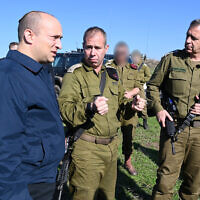 Defense Minister Naftali Bennett (L) speaks with IDF Chief of Staff Aviv Kohavi (R) and Brig. Gen. Avi Gil, head of Northern Command's 36th Division, in the Golan Heights on December 18, 2019. (Ariel Hermoni/Defense Ministry)