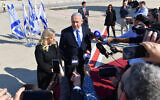 Prime Minister Benjamin Netanyahu and his wife Sara Netanyahu speaking to the press from the tarmac of Ben-Gurion Airport on December 4, 2019. (Kobi Gideon / GPO)