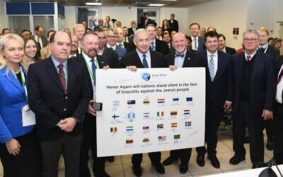 Prime Minister Benjamin Netanyahu meets with visiting pro-Israel lawmakers from 25 countries in Jerusalem on December 9, 2019 (Amos Ben-Gershom/GPO)