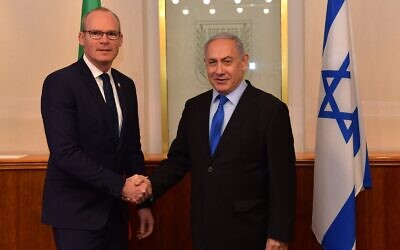 Irish Foreign Minister Simon Coveney, left, meets with PM Netanyahu in the Prime Minister's Office in Jerusalem, December 2, 2019 (Koby Gideon/GPO)