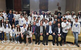 Israeli President Reuven Rivlin hosts 60 tweens and teenagers previously injured in terror attacks for a celebration of their bar and bat mitzvahs in Jerusalem on Thursday December 19, 2019.  (Kobi Gideon / GPO)