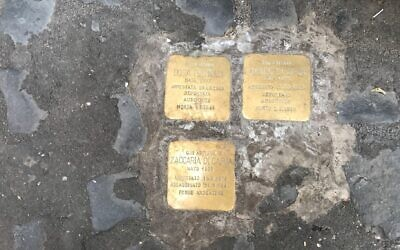 Stolperstein Holocaust memorials, or stumbling stones, in front of an apartment building in the Rome Ghetto. (Marcy Oster via JTA)