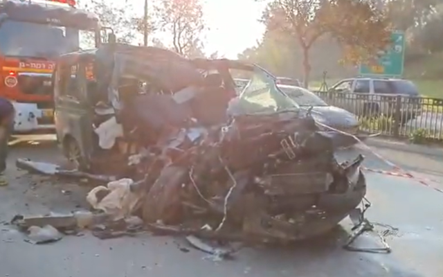 A van totaled in a deadly crash with a truck on Route 4 near the Aluf Sade Junction in Ramat Gan, December 22, 2019. (Screen capture: Twitter)