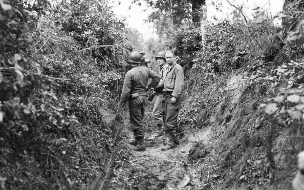 The bocage landscape of Normandy was defined by dense hedgerows surrounding agricultural fields; woody plants rooted in the earthen berm surrounding each field. German troops converted hedgerows into natural fortresses, keeping woody vegetation untrimmed to obscure lines of fire and to camouflage German artillery and snipers. (US Army/ Sumner)