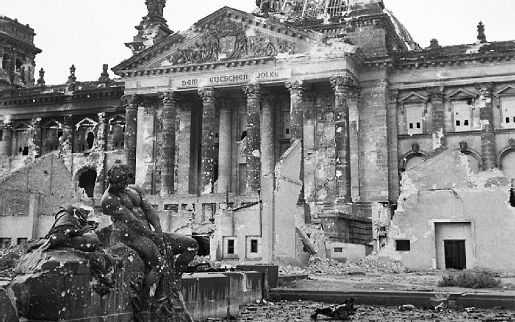 Postwar gardens were cultivated on the land surrounding the bombed remains of the Reichstag building in Berlin. British engineers plowed the land and turned it over to local residents for vegetable plots (British Armed Forces, No. 5 Army Film and Photographic Unit, Wikimedia Commons)