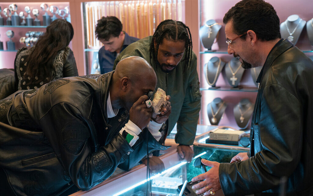 This image released by A24 shows Kevin Garnett, Lakeith Stanfield and Adam Sandler in a scene from 'Uncut Gems.' (A24 via AP)