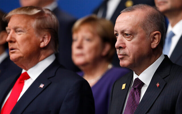 Turkish President Recep Tayyip Erdogan, right, US President Donald Trump, and German Chancellor Angela Merkel, background, pose during a photo for NATO leaders in Hertfordshire, England, December 4, 2019. (Peter Nicholls, Pool Photo via AP)