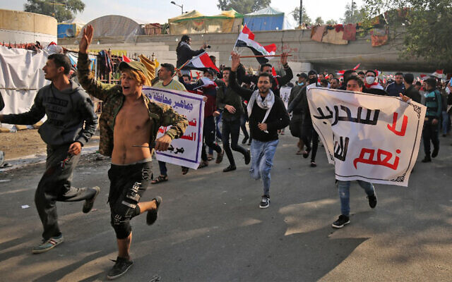 Iraqi supporters of the Hashed Al-Shaabi armed network demonstrate in Baghdad's Tahrir Square, December 5, 2019. (Ahmad Al-Rubaye/AFP)