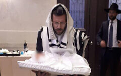 Yitzhak Meir Weiss and his son shortly after his birth. (Courtesy)