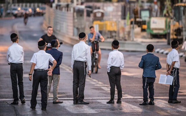 Illustrative: Ultra-Orthodox protesters block a road in Bnei Brak to oppose light rail construction work taking place on Shabbat, September 21, 2018. (Roy Alima/Flash90)