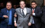 Harvey Weinstein, center, leaves court following a bail hearing, December 6, 2019 in New York. (AP Photo/Mark Lennihan)